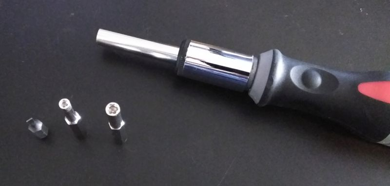 Ratcheting screwdriver with small flathead bit